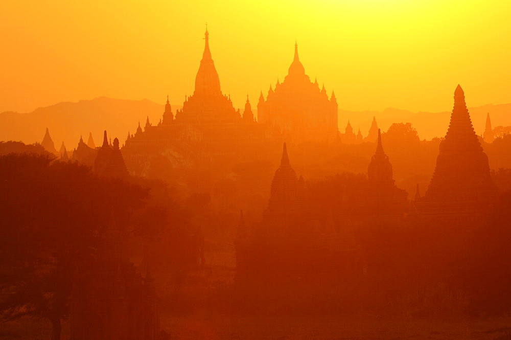 Silhouettes of the temples of the ruined city of Bagan at sunrise, Myanmar, Asia - 816-2828