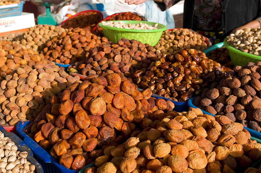 Dried fruits on market stall, Osh, Kyrgyzstan, Central Asia, Asia
