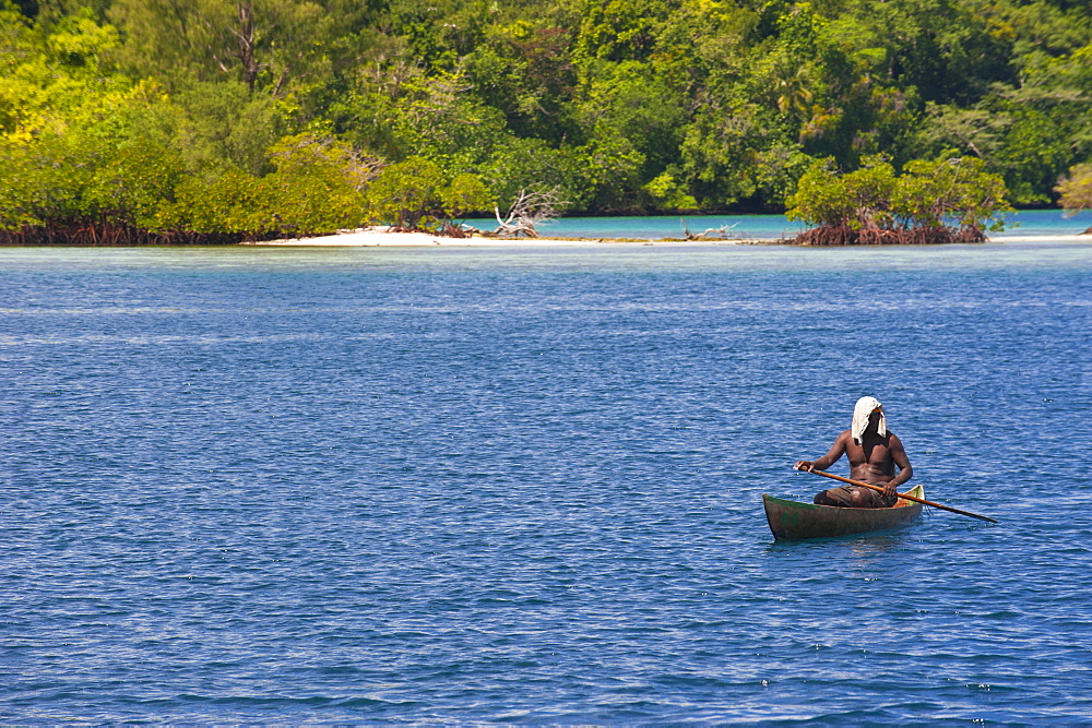 Man sitting in his canoe, Marovo Lagoon, Solomon Islands, Pacific