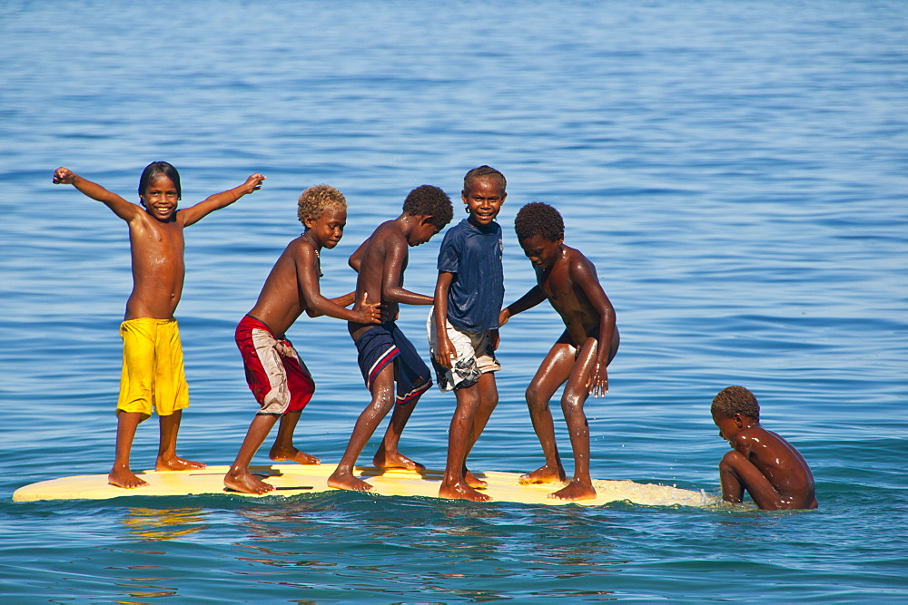Happy children playing on the beach of Savo island, Solomon Islands, Pacific