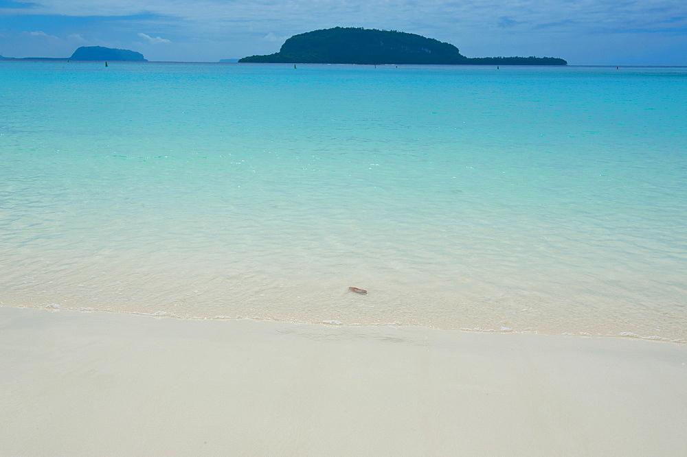 Turquoise water and white sand at the Champagne beach, Island of Espiritu Santo, Vanuatu, South Pacific, Pacific