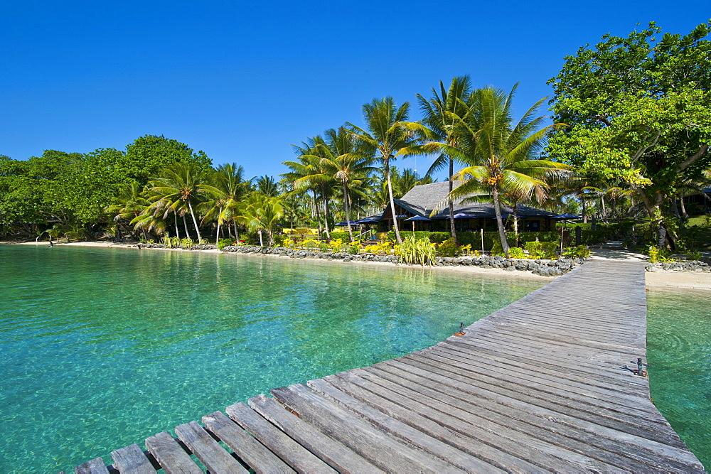 Wooden pier leadin to a resort on Aore islet before the Island of Espiritu Santo, Vanuatu, South Pacific, Pacific