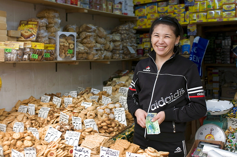 Friendly woman selling biscuits at a market stand, Alma Ata, Kazakhstan, Central Asia, Asia