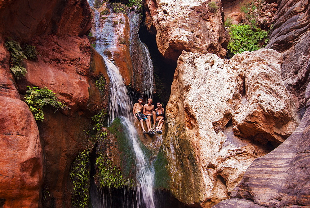 Tourists bathing in a waterfall, seen while rafting down the Colorado River, Grand Canyon, Arizona, United States of America, North America