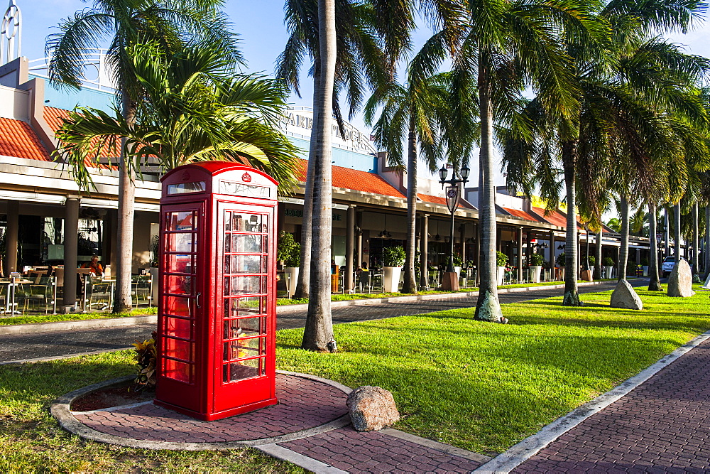 Red telephone box in downtown Oranjestad, capital of Aruba, ABC Islands, Netherlands Antilles, Caribbean, Central America