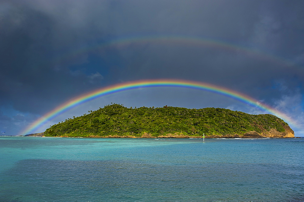 Incredible rainbow over an islet off Ofu Island, Manua Island group, American Samoa, South Pacific, Pacific