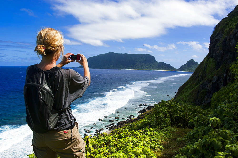 Woman trekking on Ofu Island, Manua Island group, American Samoa, South Pacific, Pacific