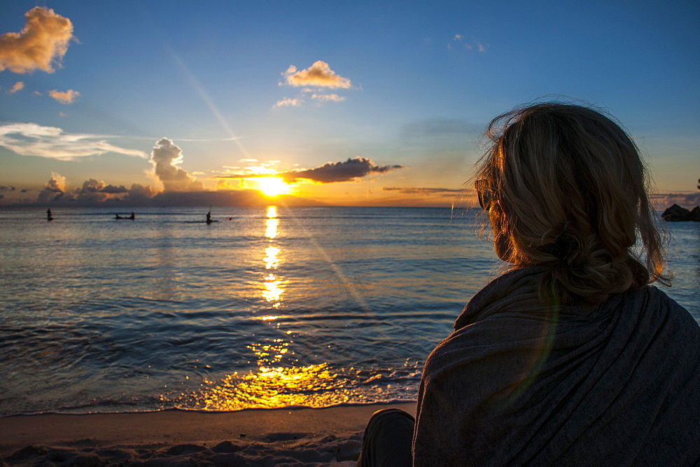 Woman watching the sunset in Guam, US Territory, Central Pacific, Pacific