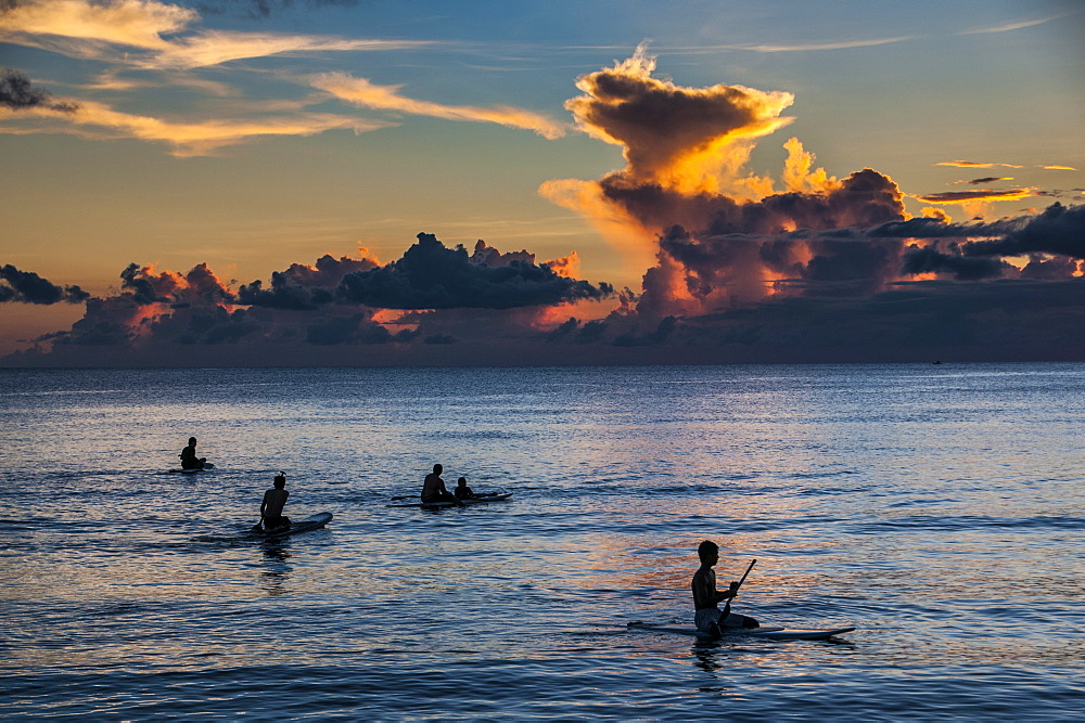 Surfer at sunset in Guam, US Territory, Central Pacific, Pacific