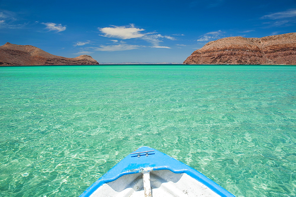 Boat in turquoise waters in Baja California