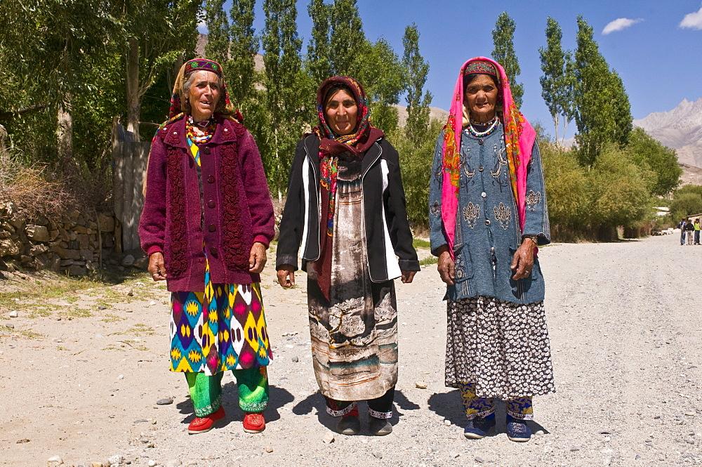 Three old Pamiri women posing for the camera, Langar, Wakhan corrior, The Pamirs, Tajikistan, Central Asia, Asia
