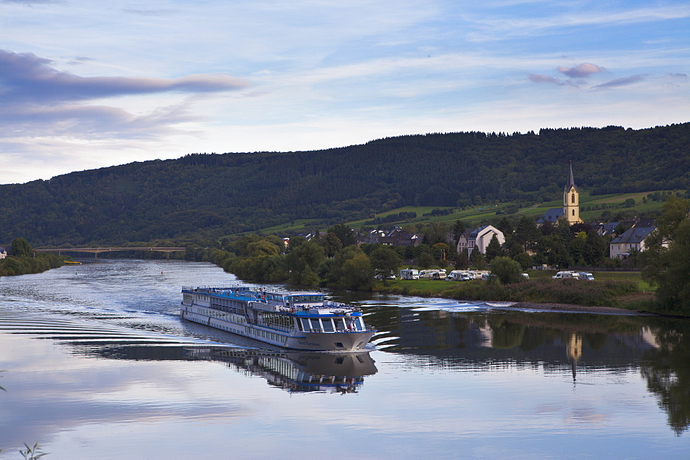 River cruise ship on the Moselle River in the late afternoon light, Germany, Europe