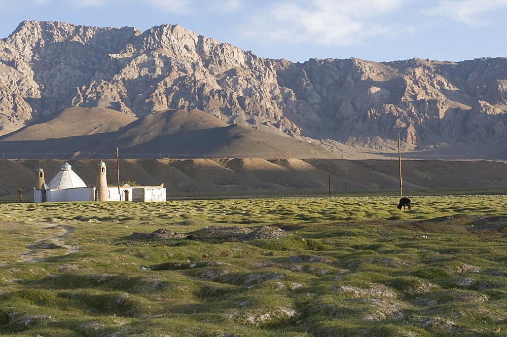 Stone Mosque in wide, rocky landscape, Murgab, Tajikistan, Central Asia
