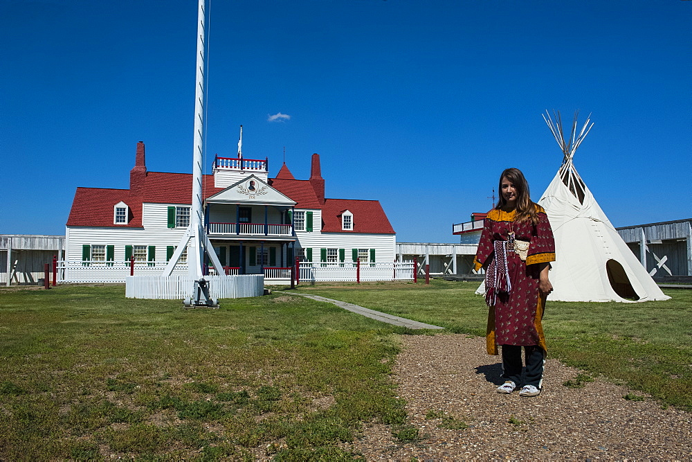 Indian dressed girl in front of a wigwam in Fort Union, North Dakota, United States of America, North America