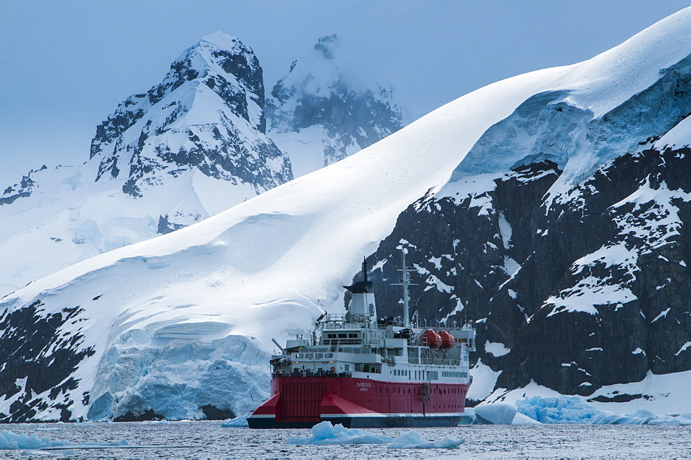 Cruise ship in front of the glaciers and icefields of Danco Island, Antarctica, Polar Regions