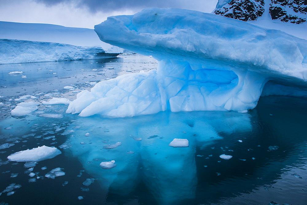 Huge glaciers shining blue, Danco Island, Antarctica, Polar Regions