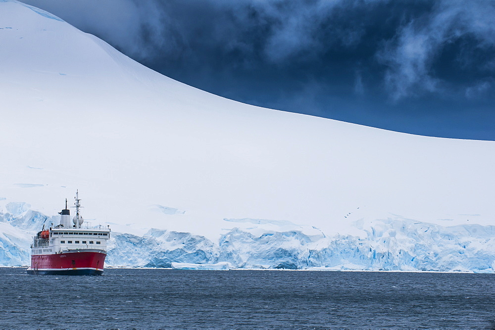 Cruise ship in the glaciers and icebergs, Port Lockroy research station, Antarctica, Polar Regions
