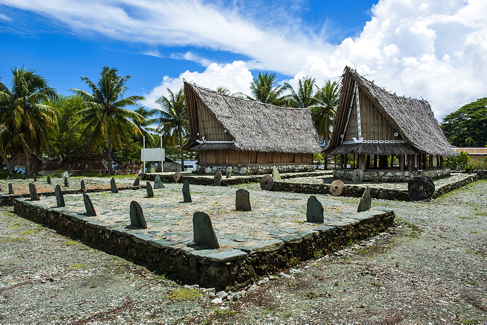 Traditional house with stone money in front, Island of Yap, Federated States of Micronesia, Caroline Islands, Pacific