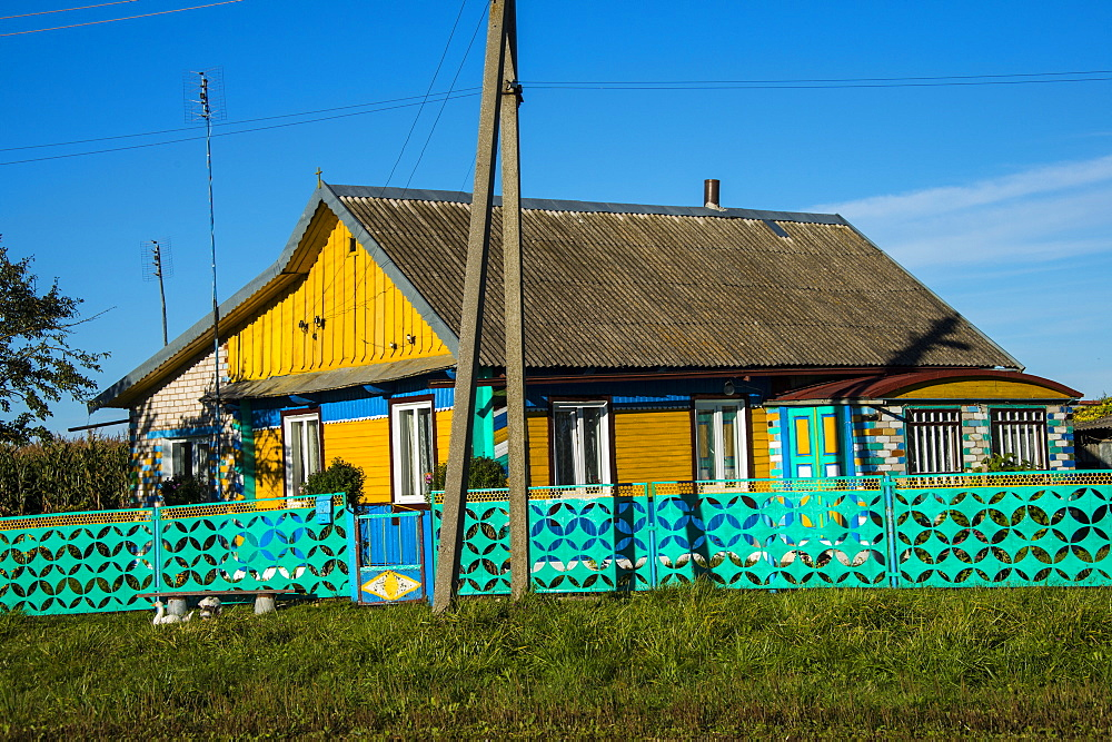 Traditional brightly painted house in the UNESCO World Heritage Site Castle Nesvizh, Belarus, Europe