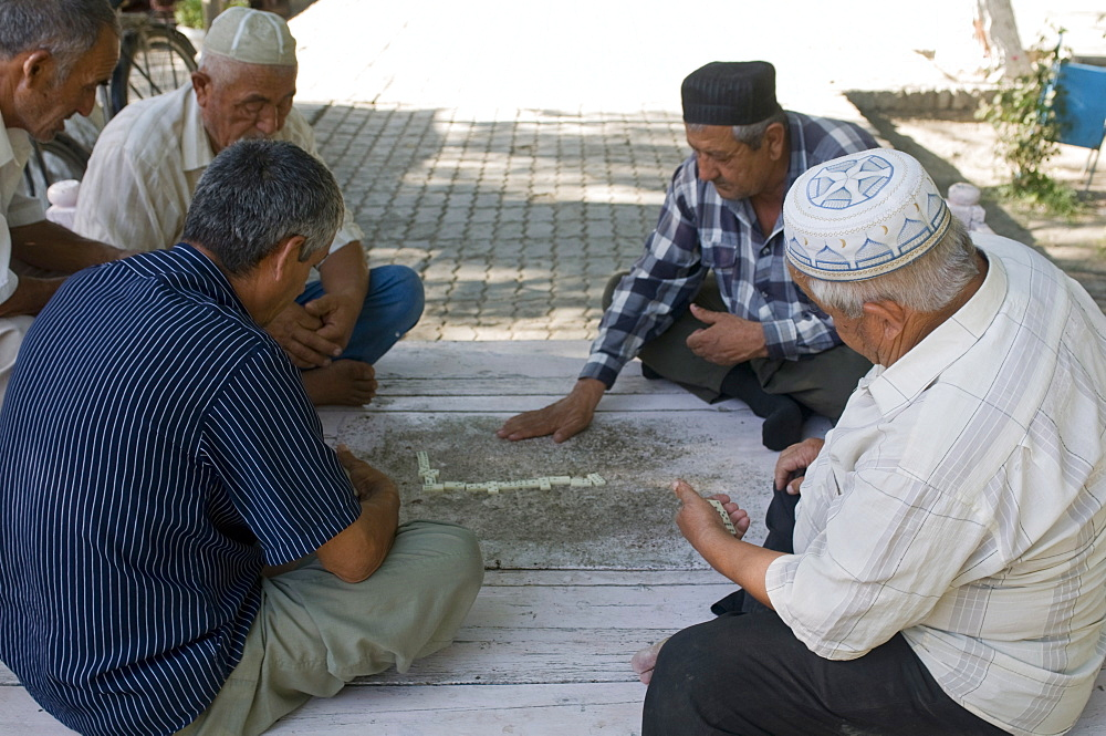 Men playing dominos, Bokhara, Uzbekistan, Central Asia, Asia