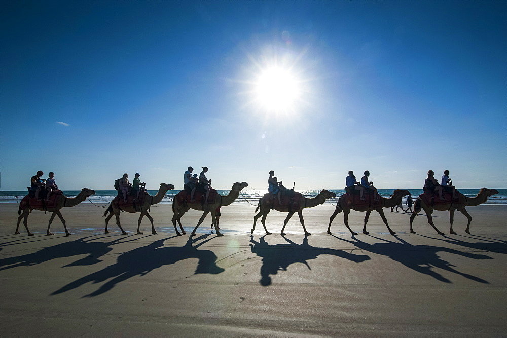 Silhouettes of tourists riding on camels on Cable Beach, Broome, Western Australia, Australia, Pacific