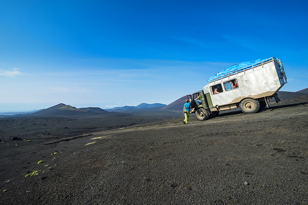 Russian truck stops at a viewpoint over the lava sand field of the Tolbachik volcano, Kamchatka, Russia, Eurasia