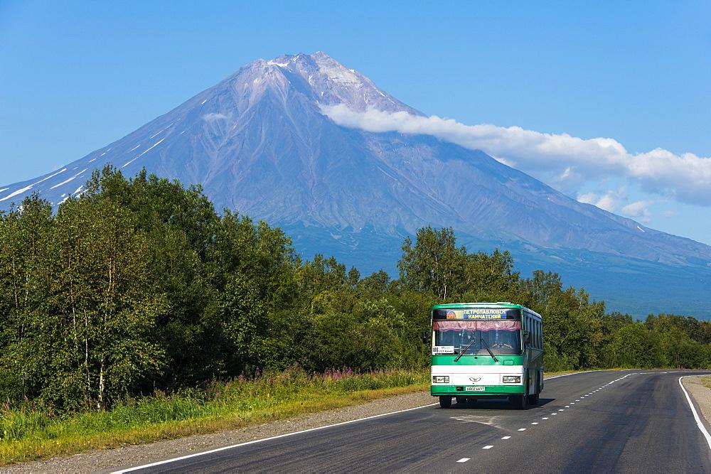 Public bus in front of the Avachinskaya Sopka volcano near Petropavlovsk-Kamchatsky, Kamchatka, Russia, Eurasia