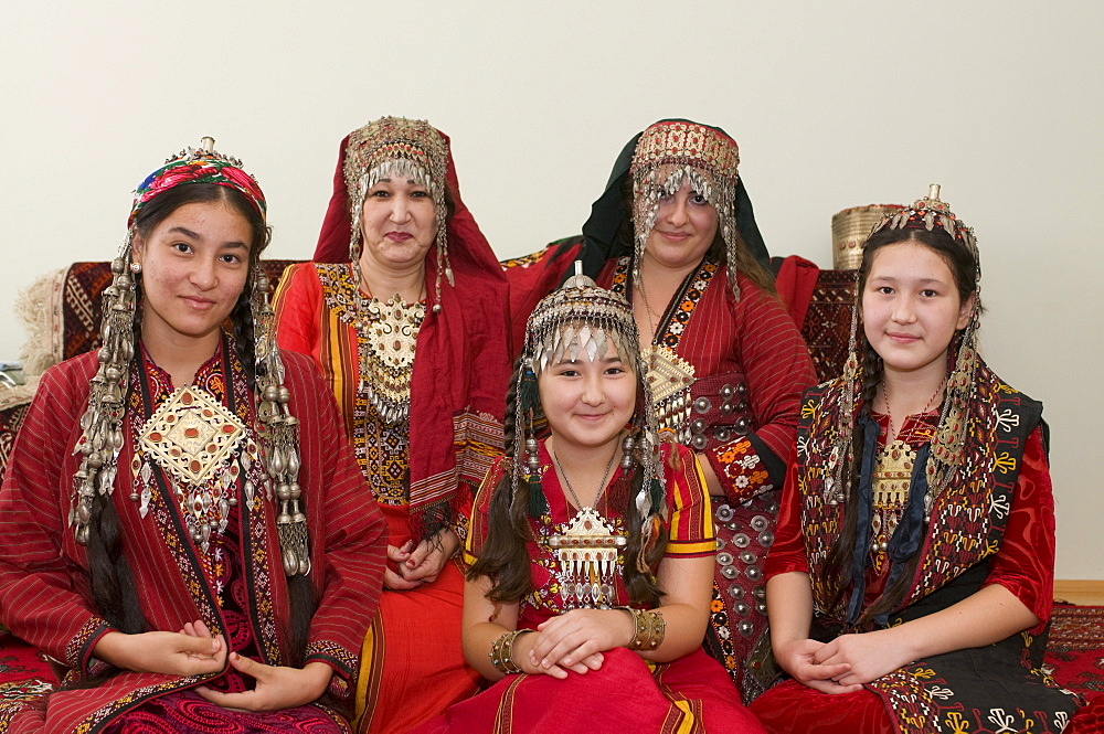 Group picture of Turkmen family in tradtional costume, Turkmenistan, Central Asia, Asia