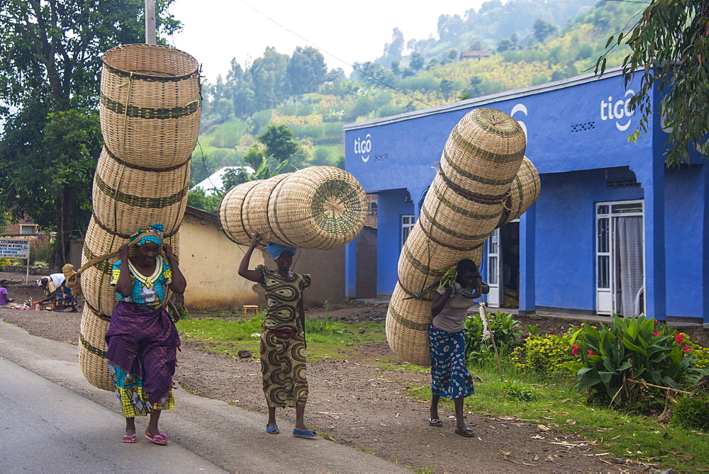 Women carrying giant baskets, Rwanda, Africa