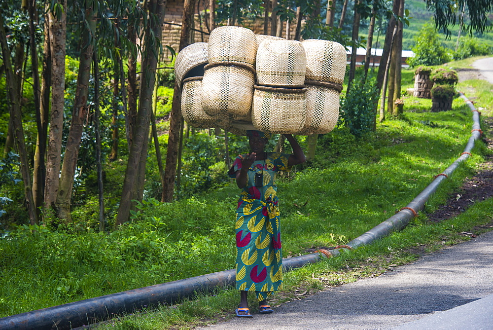 Woman carrying giant baskets, Rwanda, Africa