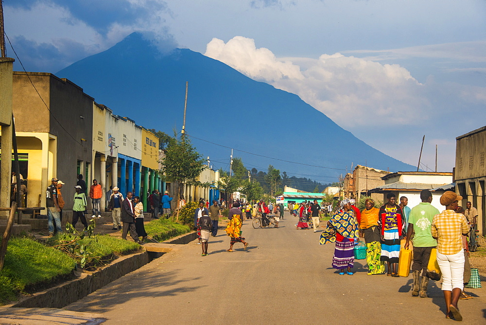 Little village before the towering volcanoes of the Virunga National Park, Rwanda, Africa