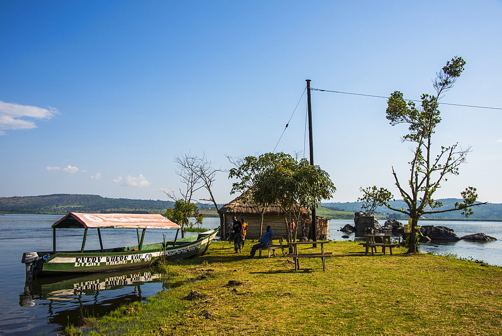 Tourist boat anchoring on a little island at the source of the Nile, where the Nile starts, Jinja, Uganda, East Africa, Africa