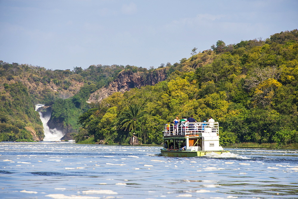 Tourist boat cruising the Nile in front of the Murchison Falls (Kabarega Falls) on the Nile, Murchison Falls National Park, Uganda, East Africa, Africa