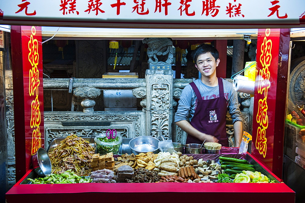 Young man in a food stall, Shilin Night Market, Taipei, Taiwan, Asia