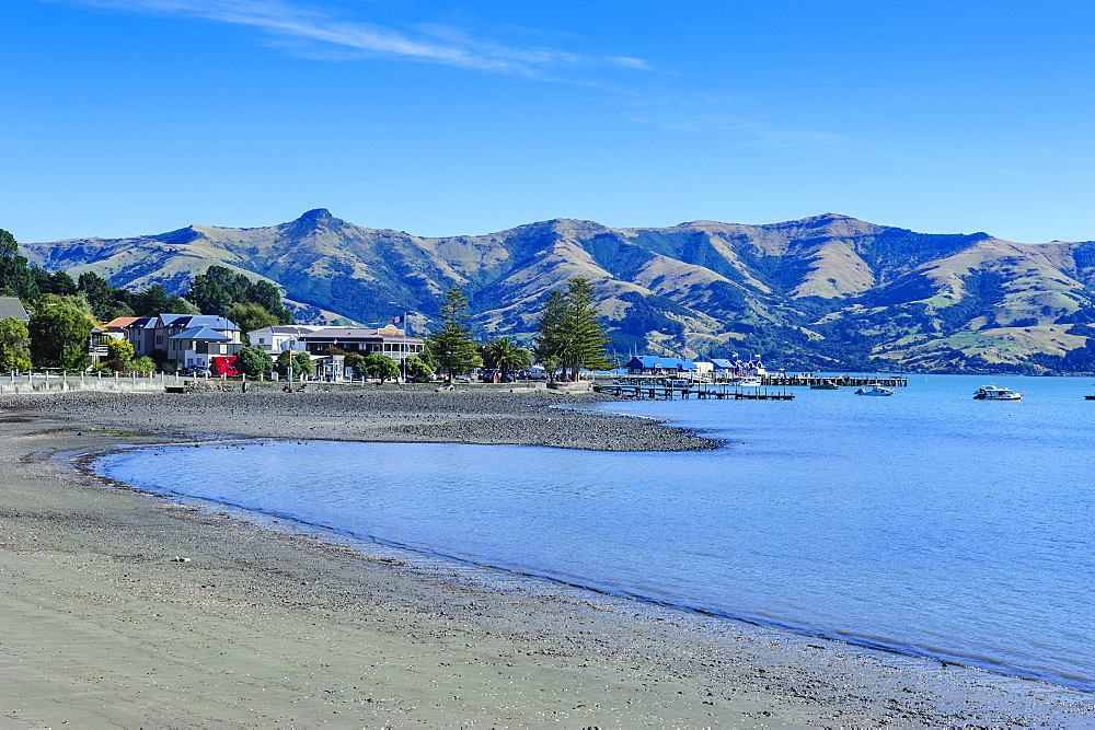 Sandy beach in Akaroa harbour, Banks Peninsula, Canterbury, South Island, New Zealand, Pacific