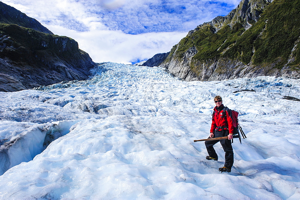 Tour guide hiking on the ice of Fox Glacier, Westland Tai Poutini National Park, South Island, New Zealand, Pacific