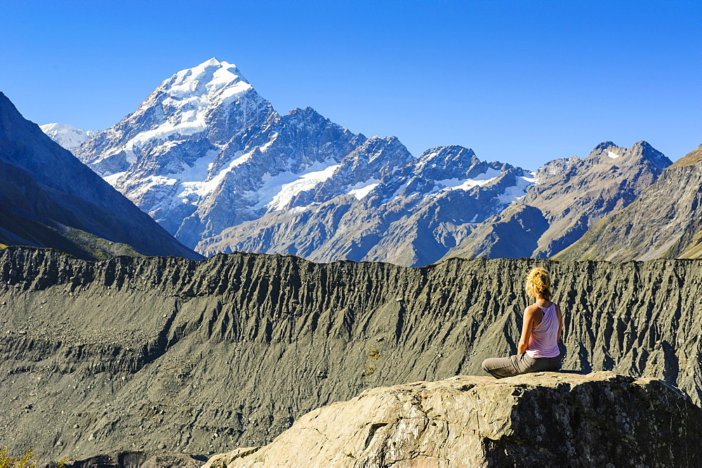 Woman enjoying the view of Mount Cook, UNESCO World Heritage Site, South Island, New Zealand, Pacific