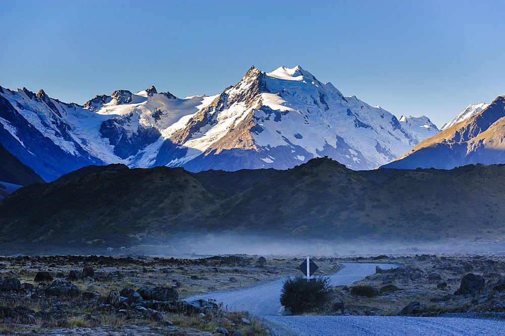 Road in Mount Cook National Park with illuminated mountains in the background, UNESCO World Heritage Site, South Island, New Zealand, Pacific
