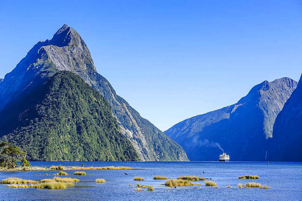 Cruise ship passing through Milford Sound, Fiordland National Park, UNESCO World Heritage Site, South Island, New Zealand, Pacific