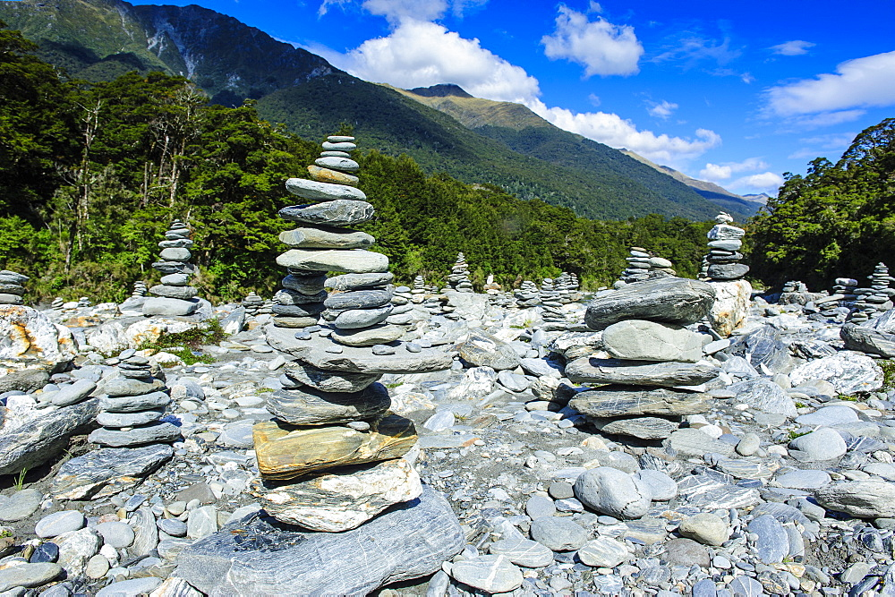 Man made stone pyramids at the Blue Pools, Haast Pass, South Island, New Zealand, Pacific