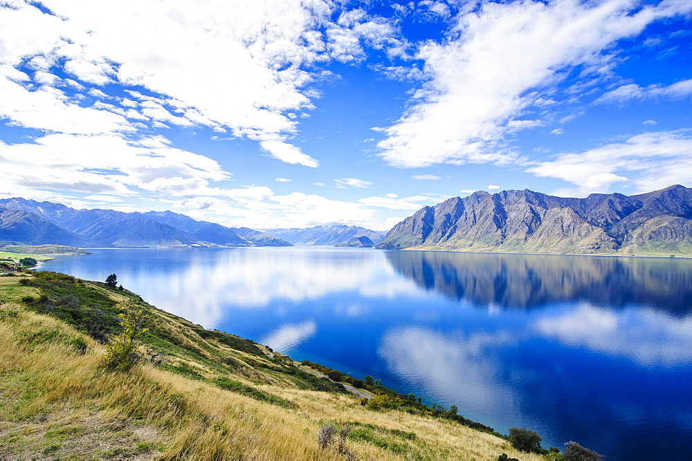 Cloud reflections in Lake Hawea, Haast Pass, South Island, New Zealand, Pacific