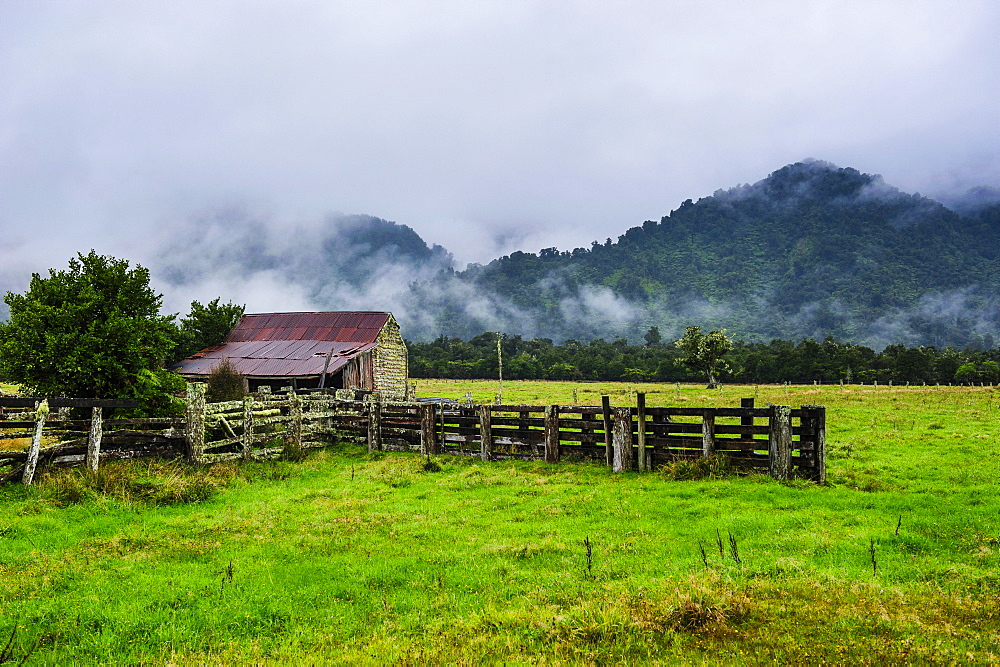 Old farm in a moody atmosphere, West Coast around Haast, South Island, New Zealand, Pacific