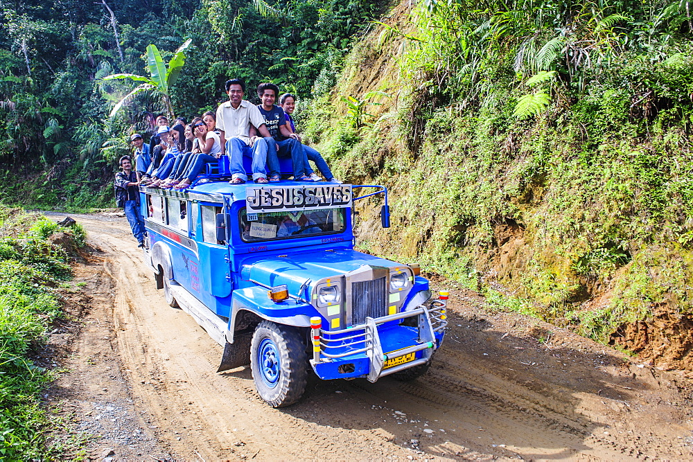 People sitting on a the roof of a jeepney driving through the Hapao rice terraces, Banaue, UNESCO World Heritage Site, Luzon, Philippines, Southeast Asia, Asia