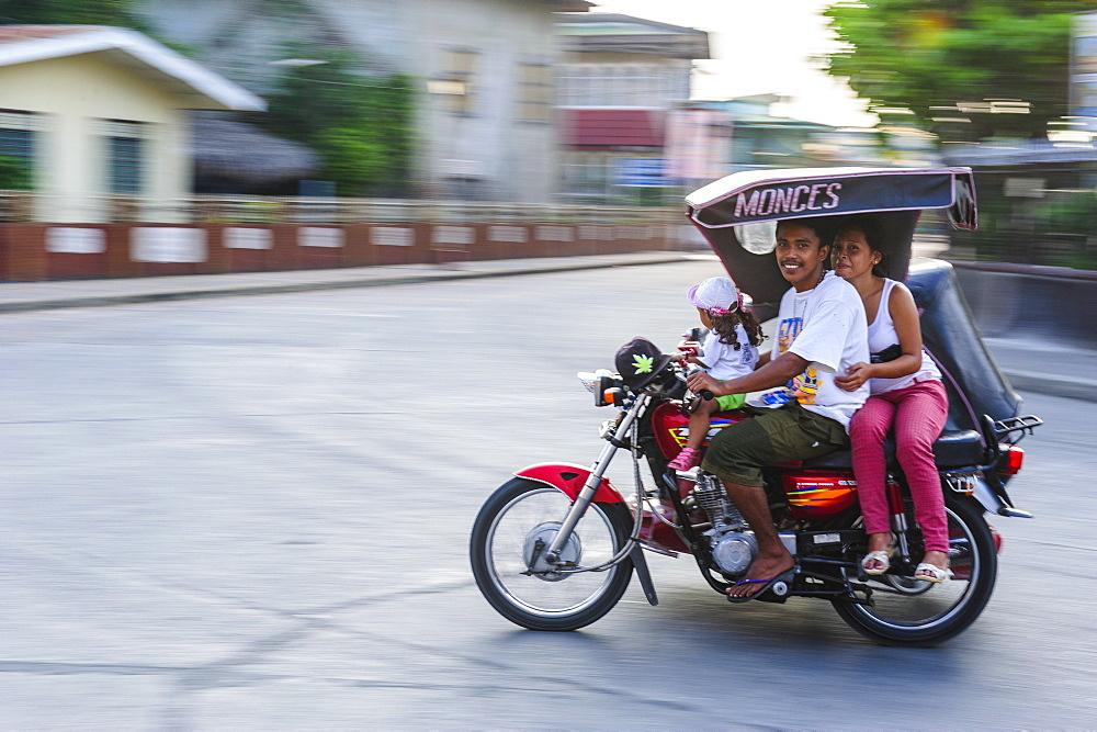 Motorickshaw driving through Santa Maria, Northern Luzon, Philippines, Southeast Asia, Asia