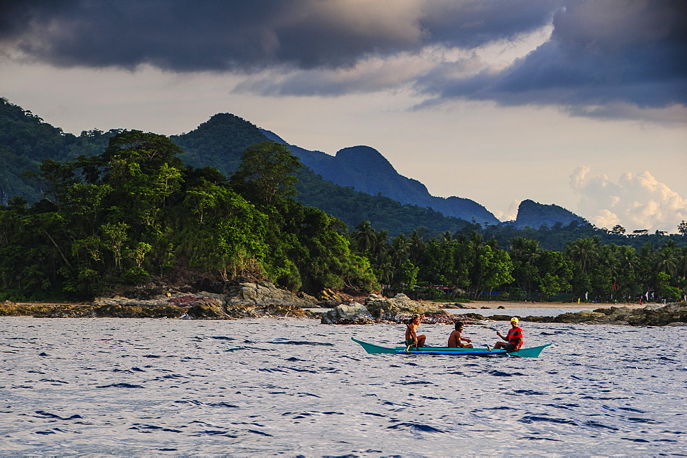 Outrigger cruising on the waters near the Puerto Princesa underground river, Palawan, Philippines, Southeast Asia, Asia