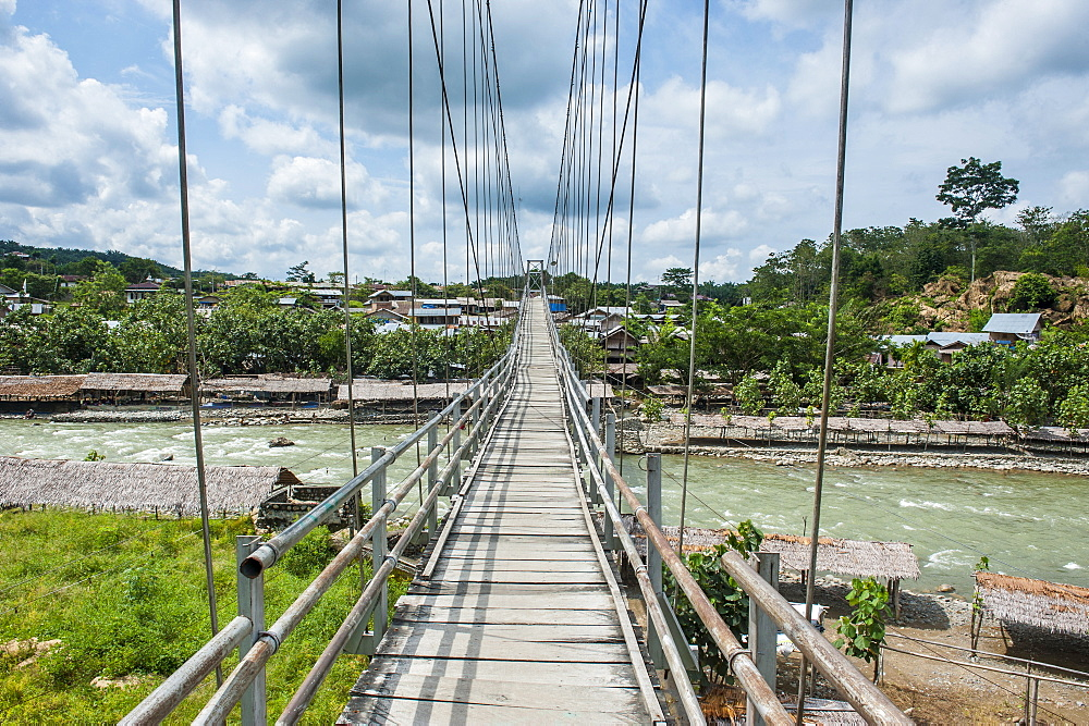 Huge hanging bridge spanning above the Bohorok river, Bukit Lawang, Sumatra, Indonesia, Southeast Asia, Asia