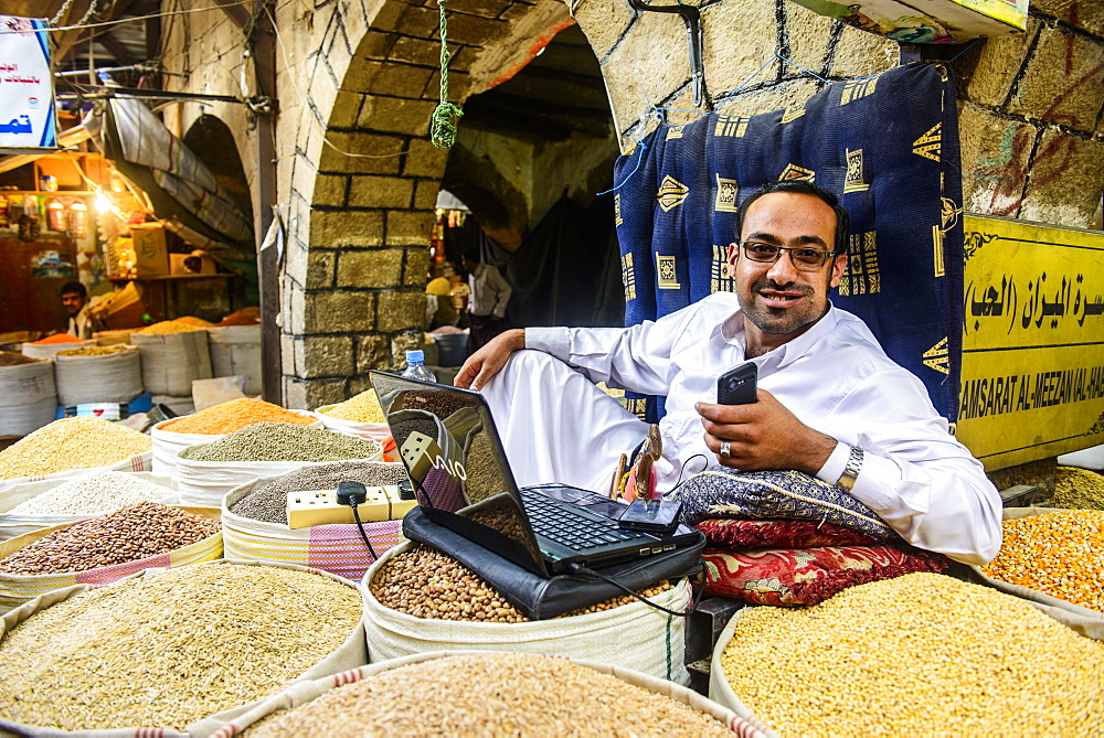 Shopkeeper at the spice market in the Old Town, UNESCO World Heritage Site, Sanaa, Yemen, Middle East