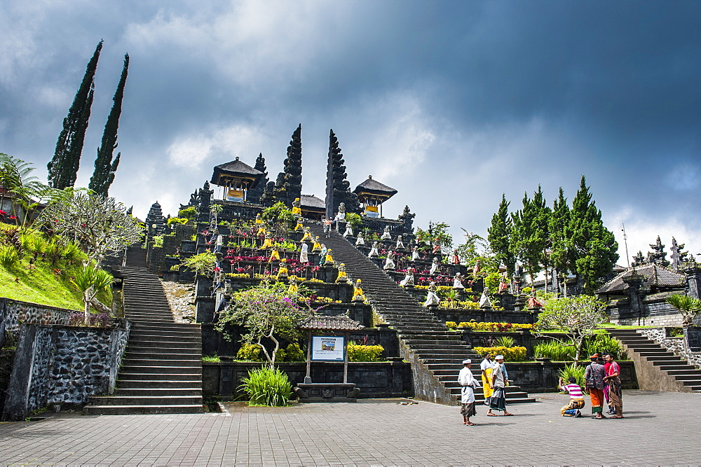 Stone statues with colourful capes in the Pura Besakih temple complex, Bali, Indonesia, Southeast Asia, Asia