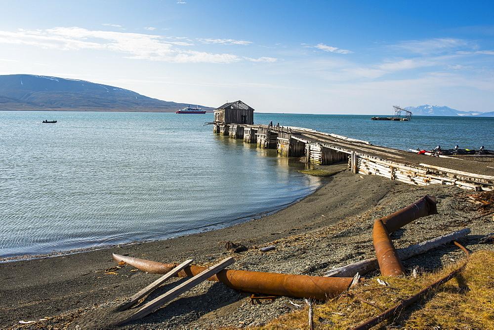 Wooden pier of the old Russian coalmine in Colesbukta, Svalbard, Arctic, Norway, Scandinavia, Europe