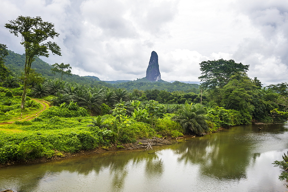 River flowing before the unusal monolith, Pico Cao Grande, east coast of Sao Tome, Sao Tome and Principe, Atlantic Ocean, Africa